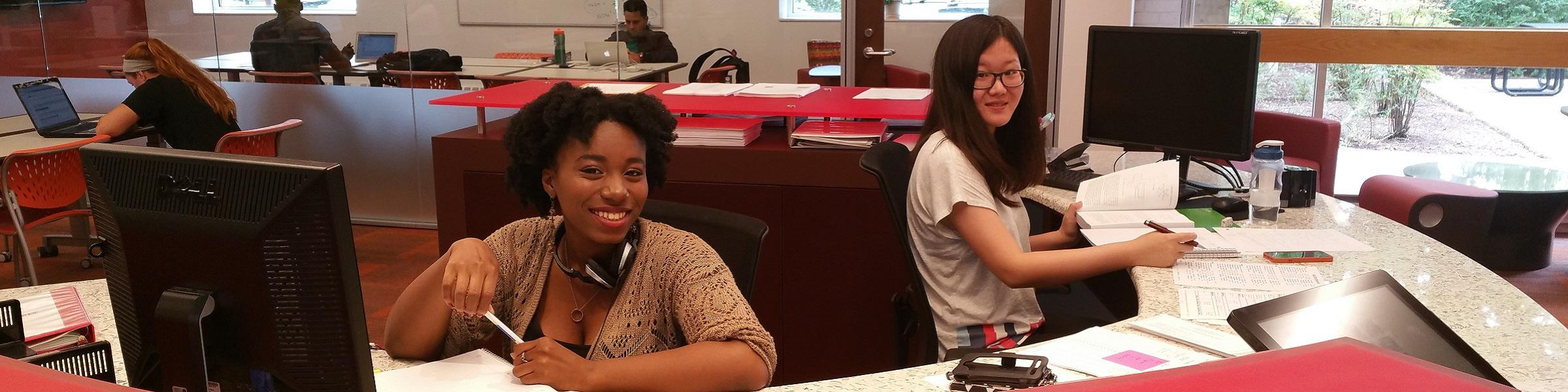 Student staff at front desk of Livingston Learning Center