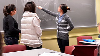 Students participating at chalkboard.